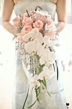 Cascading bouquet of orchids and roses