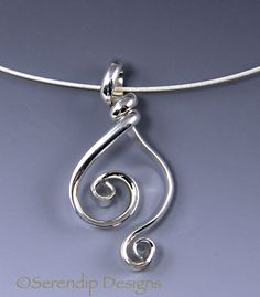 This unique Argentium Sterling Silver double spiral pendant is handmade out of domed, tarnish-resistant wire. I hand forged this pendant and
