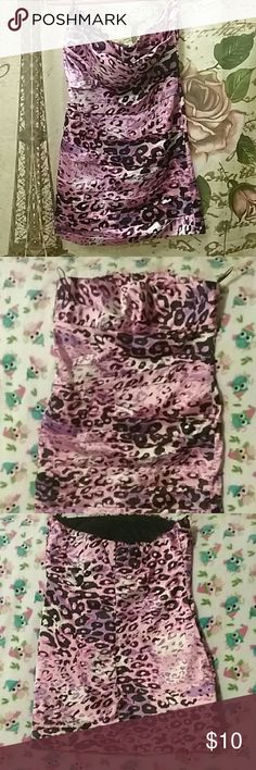 Really pretty purple print dress. This dress is a strapless, size large, purple leopard print dress. The little loops for it to be hung up are still attached,the chest has some light lineing in it for extra support, and the back has a zipper close. Snap Dresses Mini