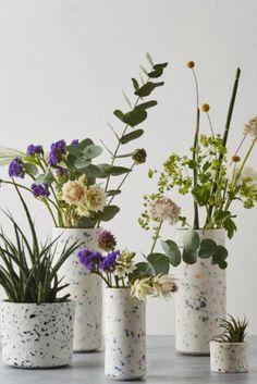 Beautiful flower arrangements featuring natural wild flowers in handmade ceramic terrazzo vases