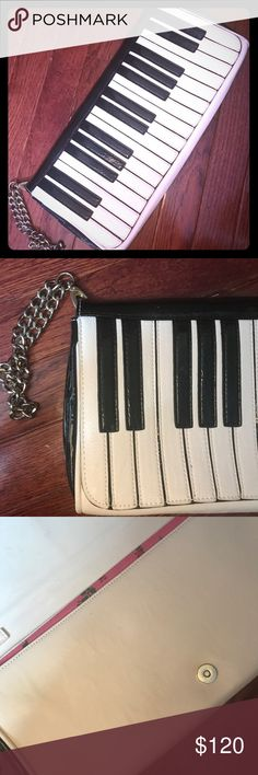 Betsey Johnson Piano Purse This comes as a wristlet and has no damage whatsoever, as you can see it is in keyboard 🎹 shape black and white. Another cute bag by betsey Johnson. Open to Offers! Betsey Johnson Bags Clutches & Wristlets