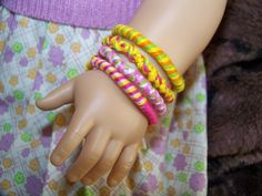 With Glittering Eyes: Using a Loopdedoo Spinning Tool to make Friendship Bracelets for American Girl Dolls-- how-to info is on the blog post.