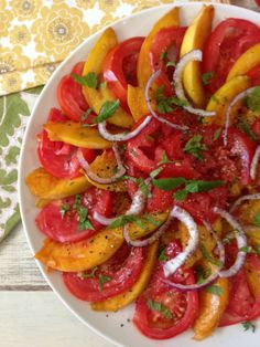Peachy Tomato Salad - A light, healthy peach and tomato layered salad made with all fresh ingredients from the garden. It's seasoned with fresh mint and thyme and just drizzled with a little olive oil.