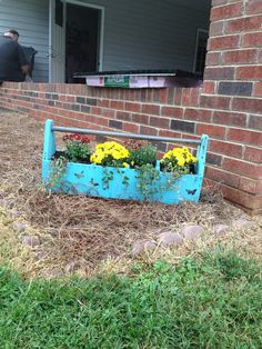 Chalk paint an old wooden tool box and plant flowers in it...love it!