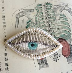 Gorgeous handmade eye brooch with pearls by zoomy on Etsy
