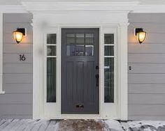 Blue Craftsman front door with sidelights, white trim.