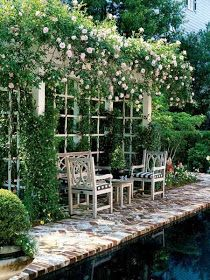 Cute seating under Rose trellis.