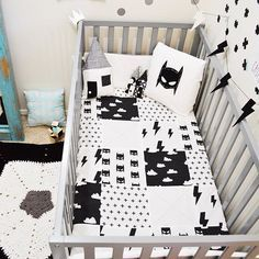 SleepingLakeDesigns Batmask Batman Nursery Crib Bedding Set with clouds, lightning bolts, swiss crosses, and batmasks. Taken from SleepingLakeDesigns Instagram Feed. Nursery baby room decor ideas for hipster and monochrome black and white nurseries.