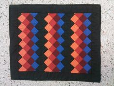 About.com Amish themed doll swap quilt made in a Seminole patchwork pattern.