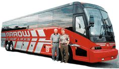 Owners Doyle Busskohl and Steve Busskohl in front of Arrow Stage Lines motorcoach.