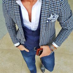 Dressing up jeans with a crisp, white shirt, waistcoat and blazer