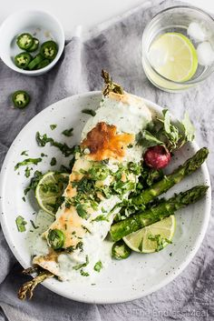 These Spring Veggie Enchiladas are stuffed with loads of healthy spring vegetables, your choice of tofu or chicken, and then smothered in an easy to make creamy yogurt sauce. They are a ridiculously delicious dinner recipe. | theendlessmeal.com