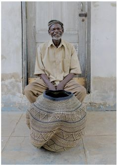 """This basket was created by the calming presence of John Akurigo. Along with Palash Singh of the National Institute of Design, Ahmedabad, India, John was the creator of the """"Pakurigo Wave"""" basket. Weaving Textiles, Weaving Art, Hand Weaving, National Institute Of Design, Afrique Art, Basket Decoration, Decorative Storage, Land Art, Wire Art"""