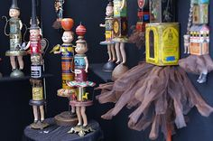 More vintage tins, antique doll parts, and salvaged metal are recycled into decorative doll sculptures by Primitive Twig