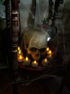 Grunge up some cheap led lights and place around a skull. Gives a great creepy vibe and so simple!