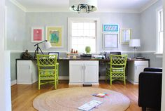 Home office at Young House Love.  Really like the muted stenciling on the walls, how the round rug finishes off the space, and those green chairs really add zing.