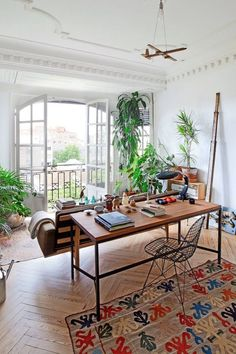 Plant-filled living room in a creative Madrid apartment