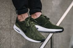 On-feet images of the Nike Air Max Modern Flyknit in the Rough Green colorway.