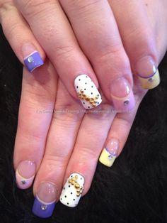 Acrylic nails with pastel tips and polka dots