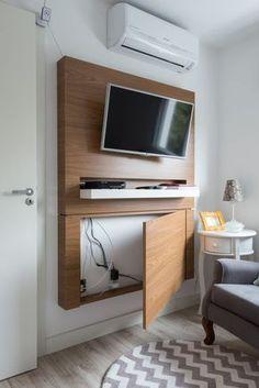 Soporte de TV en pared con cables ocultos. Dormitorio o comedor diario.