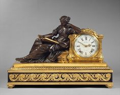 Mantel clock Clockmaker: workshop of Julien Le Roy  (Tours 1686–1759 Paris, master clockmaker 1713–59) Maker: Case maker: Joseph Baumhauer (French, active ca. 1749–72) Modeler: Bronze figure from a model by Laurent Guiard (1723–1788) Date: ca. 1757–60 Culture: French, Paris Medium: Case of gilded and patinated bronze on a base of oak veneered with ebony; dial of white enamel; movement of brass and steel Dimensions: H. 19 x W. 27-1/2 x D. 11 in. (48.3 x 69.9 x 27.9 cm)