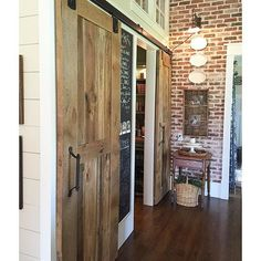 Love the pics, plates light on brickBarn wood sliding doors for pantry eclecticallyvintage.com