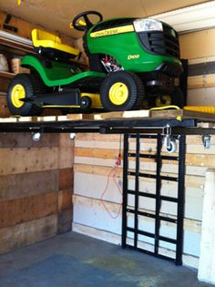 Let Garage Evolution transform your space with Motorcycle u0026 ATV Lifts Installation for your Garage. & Garage storage lift. hubby needs this! | Music Heros u0026 More ...