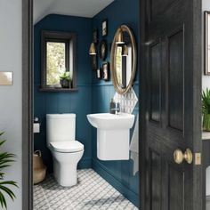 Quirky and compact under stairs cloakroom. The deep blue walls allow the compact pottery to stand out, patterned ceramic floor tiles with splash back adds to the character. The vintage gold mirror sits perfectly with the designer copper wall lights. Cloakroom Toilet Downstairs Loo, Bathroom Under Stairs, Toilet Under Stairs, Down Stairs Toilet Ideas, Bathroom Design Small, Bathroom Interior Design, Quirky Bathroom, Navy Bathroom, Interior Ideas