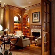 Interesting porthole clerestory windows above  lighted bookcases, and some beautiful millwork...
