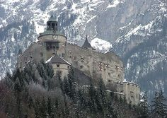 """Hohenwerfen Castle (German: Burg Hohenwerfen) stands high above the Austrian town of Werfen in the Salzach valley, approximately 40 km (25 mi) south of Salzburg. The castle is surrounded by the Berchtesgaden Alps and the adjacent Tennengebirge mountain range. The fortification is a """"sister"""" of Hohensalzburg Castle both dated from the 11th century."""