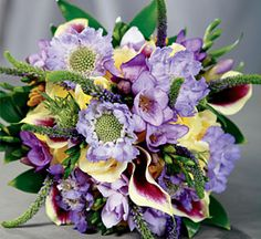 Beautiful!! Mini calla lilies, kangaroo paws, yellow roses, scabosia, fresia, veronica, omcidium, and cocculus greens