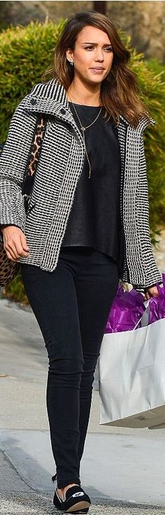 Who made Jessica Alba's leopard print bag and black print jacket?