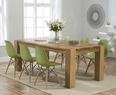 Buy the Madrid 200cm Solid Oak Extending Dining Table with Charles Eames Style DSW Eiffel Chairs at Oak Furniture Superstore