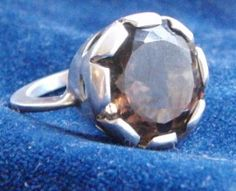 Beautiful handmade sterling silver ring with a checkerboard smokey quartz. for sale € 65,00