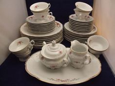 Vintage Wawel dinnerware set, 8-place settings. Made in Poland. White background with rose garden motif and gold paint trim. Been in my family for 30+ years. If you were to piece out a set of this size on Replacements, LTD, it would cost you over $470.00! This 44 piece set is a bargain at only $250, or make me an offer and maybe we can work something out.