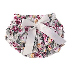 Gorgeous vintage baby bloomers for girls in 100% cotton floral fabric. Tiered ruffles and satin bow make these bloomers just adorable.