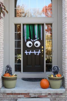 The Best 35 Front Door Decors For This Year's Halloween - Opt for something fun and simple and turn your front door into a cute yet scary monster. Use two plates for the eyes and tape for the mouth.{found on moderndaymoms}.