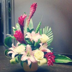 #Beautiful #flower #arrangement out of our Riverbend location!! #tropical #ginger , #lush greenery and #pink #lilies with #cream #roses!