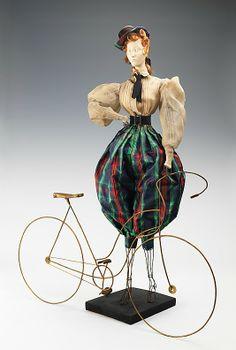 """1900 Doll""  Calixte (French)  Designer: Maud et Nano   Designer: Phyris   Date: 1949   Culture: French   Medium: metal, plaster, hair, silk, cotton, rhinestones   Dimensions: (a): 30 1/2 x 14 in. (77.5 x 35.6 cm) (f): 17 x 25 in. (43.2 x 63.5 cm)   Credit Line: Brooklyn Museum Costume Collection at The Metropolitan Museum of Art, Gift of the Brooklyn Museum, 2009; Gift of Syndicat de la Couture de Paris, 1949"