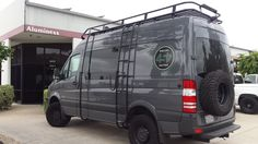 454 Tattoo and Body Art owner added some van art to his Mercedes Sprinter...Aluminess roof rack, ladder, surf pole and hooks, and light bar!