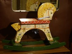 White horse - painted by hand vintage wooden rocking horse. $220.00, via Etsy.
