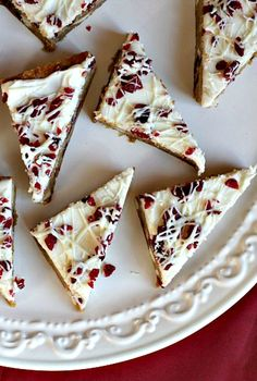 """This week, I baked Cranberry Bliss Bars. The recipe originally comes from Taste of Home. They call them """"White Chocolate Cranberry Blondies,"""" but if you're a Starbuck's fan… they're clearly Cranberry Bliss Bars. Köstliche Desserts, Holiday Baking, Christmas Desserts, Christmas Baking, Health Desserts, Plated Desserts, Christmas Holidays, Xmas, Cranberry Bliss Bars Starbucks"""