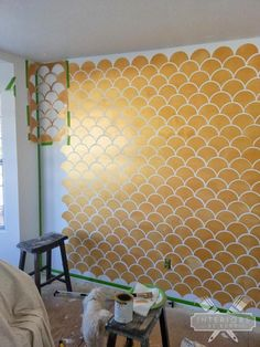 Stencil a gold and white scallop accent wall
