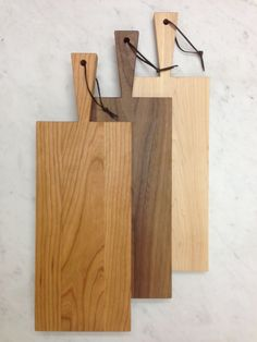 Narrow wooden paddle boards available in Cherry, Walnut & Maple.