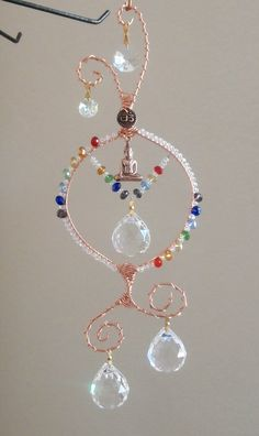 Crystal Chakra Suncatcher with Buddha, Om,Made to order, multi Prims, Feng Shui, rainbow maker, window ornament, free shipping X003. $46.00, via Etsy.