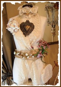 altered mannequin with vintage doilies and lace