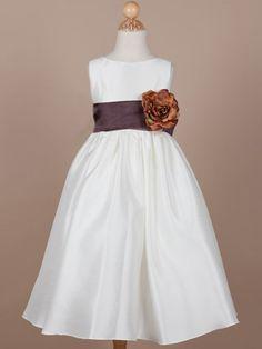 Adorable sleeveless flower girl dress with a calf-length skirt.