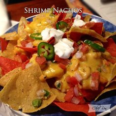 Cheddar and Monterey Jack cheese served over crisp nacho chips, and then topped with pico de gallo and shrimp. The cheese that tops these nachos is thick and creamy and so much better than just a cheddar cheese sauce. So you are in for a real treat with these nachos.