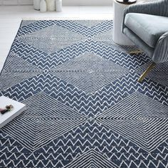 Our Traced Diamond Kilim Rug is our mid-century-inspired take on traditional Japanese indigo textiles. Featuring an intricate diamond design, it's handwoven by skilled Indian artisans on a punja loom, replicating centuries-old techniques.