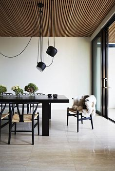The black furniture works so well in the dining area because of the generous size of the room. Floor to ceiling windows add to a sense of openness. The timber ceiling and lighting arrangement draw the eye upward and create interest. Timber Ceiling, Wooden Ceilings, Wood Ceiling Panels, Wooden Ceiling Design, Dark Ceiling, Ceiling Cladding, Ceiling Lighting, Decoration Inspiration, Interior Inspiration